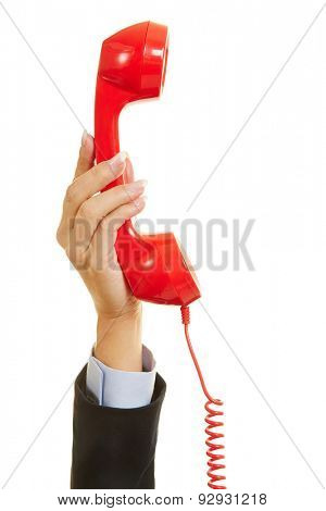 Hand of a woman holding a red phone for emergency call