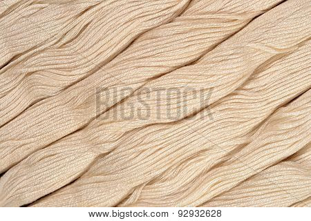 Beige Skeins Of Floss As Background Texture