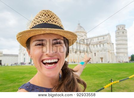 Closeup Of Happy Female Tourist Pointing To Tower Of Pisa