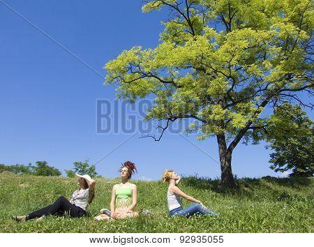 Three Women Enjoying The Sun In Nature