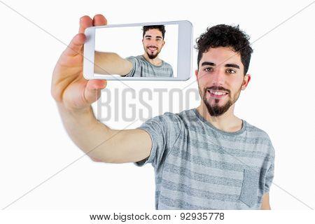 Casual man taking a selfie shot in studio