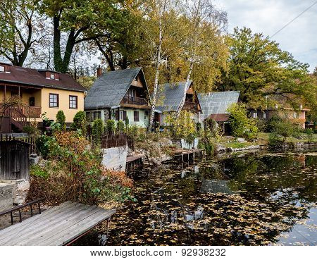 Chalets And A Pond