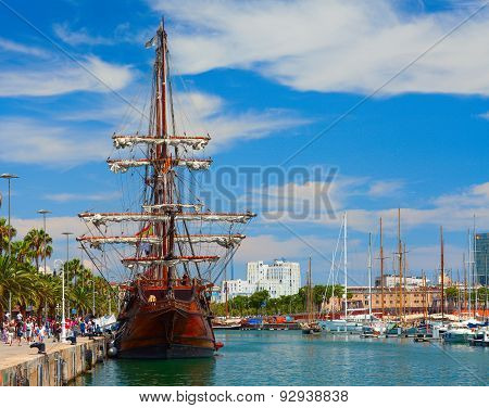 BARCELONA, SPAIN .Central city quay with an old sailboat rebuilt as museum.