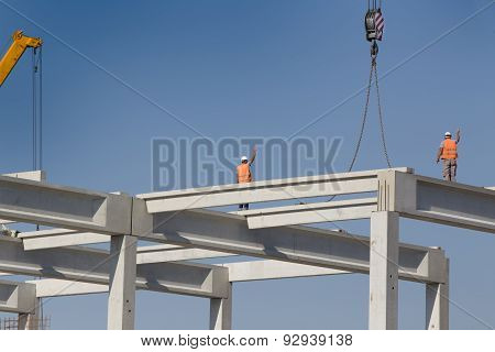 Height Worker Standing On Truss On Building Skeleton