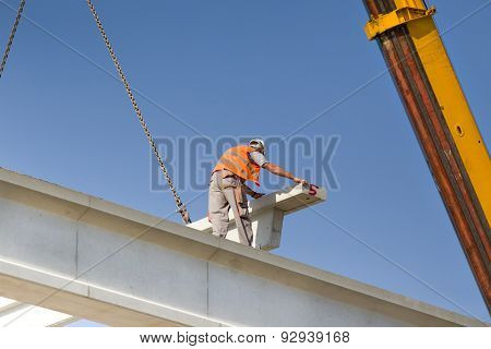 Height Worker Placing Truss In Skeleton