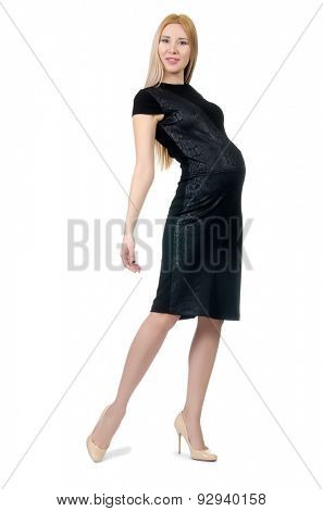 Pretty pregnant woman in black dress isolated on white