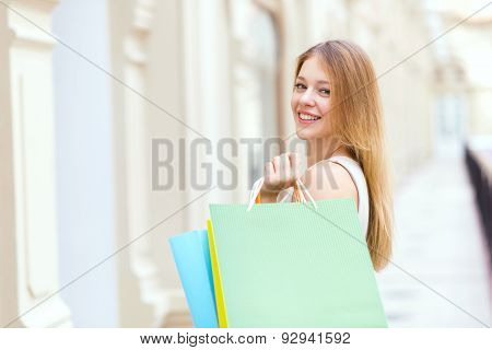 A Happy Young Woman With The Colourful Shopping Bags From The Fancy Shops.