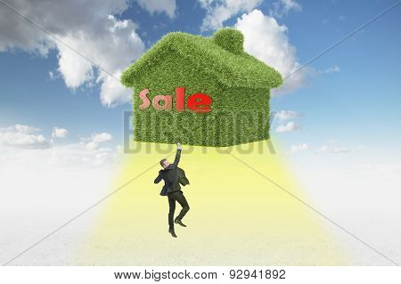 Confident Real Property Agent Just Sold A House. Taking Off House And Businessman.