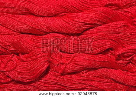 Red Skeins Of Floss As Background Texture