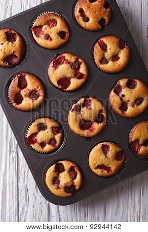 Berry Muffins Close Up In Baking Dish. Vertical Top View