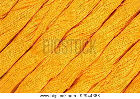 Yellow Skeins Of Floss As Background Texture