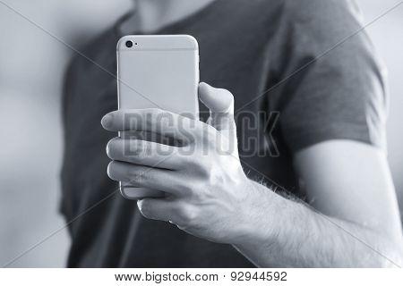Man using smart phone close-up