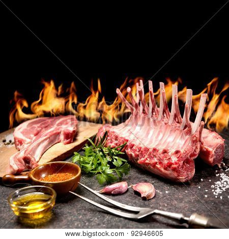 Rack of lamb with seasoning in front of a fireplace