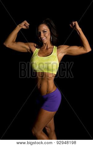 Woman Blue Shorts And Green Sports Bra On Black Flex Both Arms