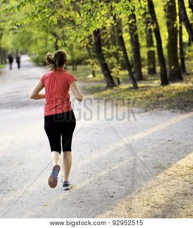 young female jogger exercising in the park