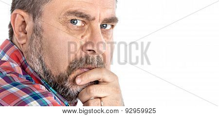 Thoughtful Middle Age Man With Hand Near The Face