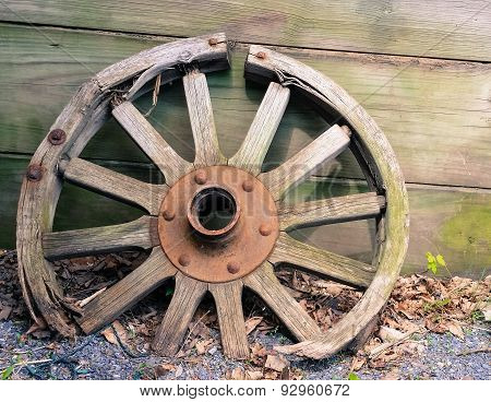 wooden wheel with broken spokes