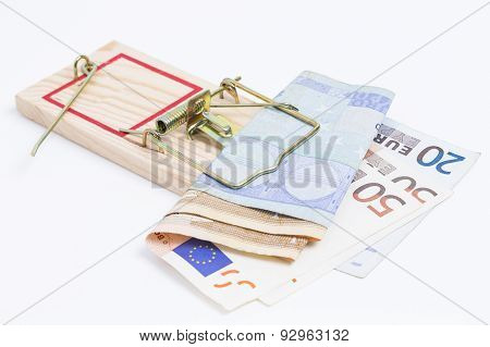 Banknotes in mousetrap