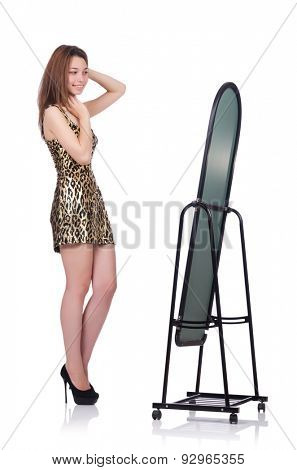 Woman choosing clothing in front of mirror