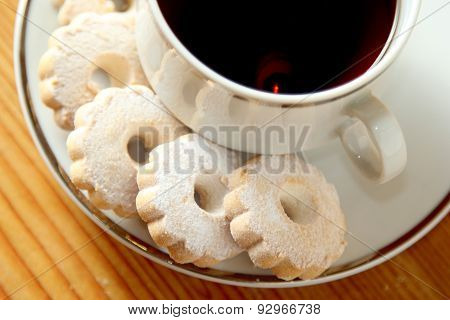 Italian Canestrelli Cookies On The Saucer Of A Cup Of Black Tea