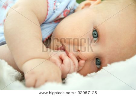 Newborn Baby Girl Laying Down Sucking Her Thumb