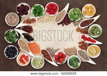 Diet detox super food selection in porcelain bowls over parchment paper and brown background.