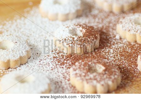 Italian Canestrelli Biscuits Covered With Powdered Sugar And Cocoa