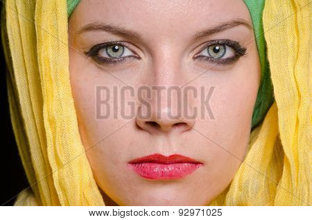Serious woman wearing colourful headscarf