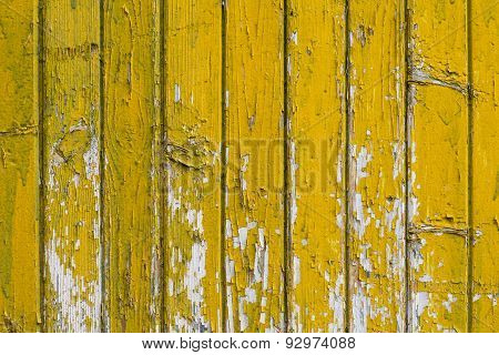 Background with old wooden yellow painted planks