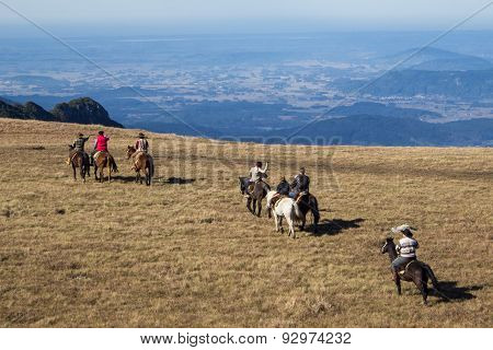 SAO JOSE DOS AUSENTES, BRAZIL - JUNE 05: Tourists ride horses visiting a Canyon on June 05, 2015