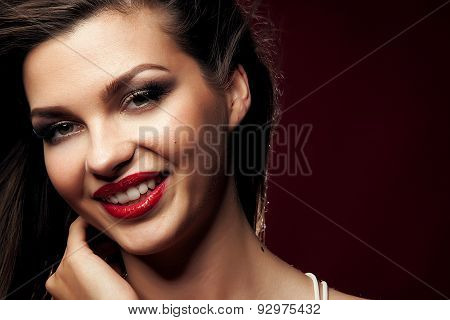 Portrait Of Brunette Smiling Girl.