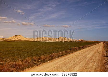 dirt track through Bardenas Reales desert Spain