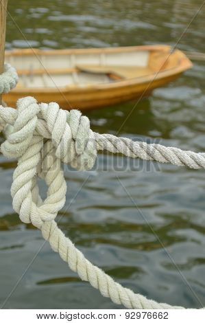 Nautical Knot and Brown Boat