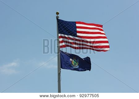 United States fifty Star flag and State of Maine Flag with nice sky background