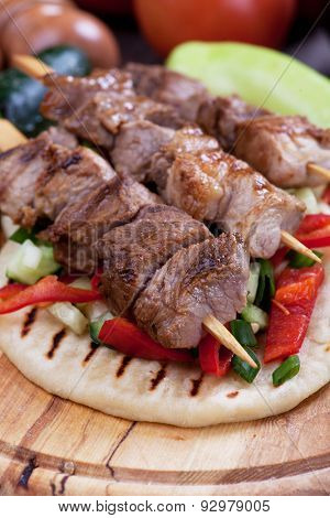 Souvlaki or kebab, grilled meat skewer and pita bread