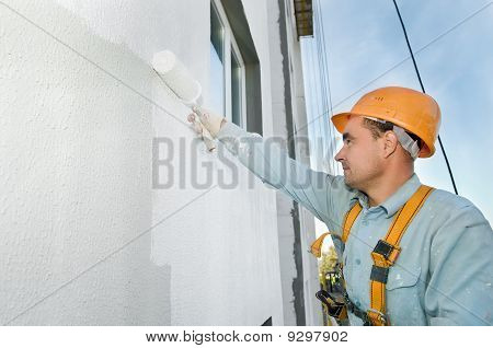 Builder Facade Painter At Work