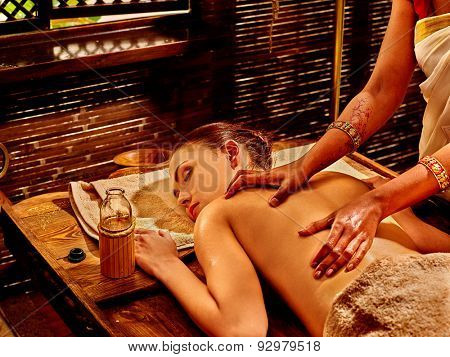 Young woman having oil spa treatment.