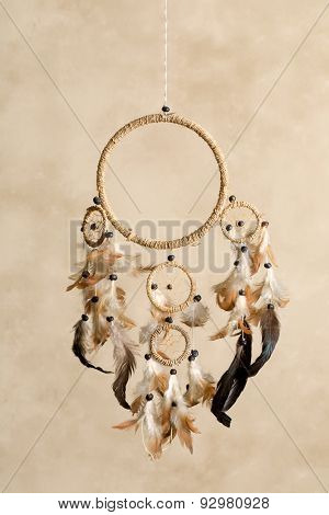 Native American dreamcatcher made of brown feathers - the center part is cutout to photoshop a baby or any object or text in it
