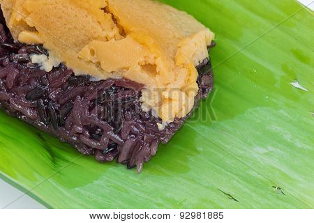 Black Sticky rice with custard wrapped in banana leaves