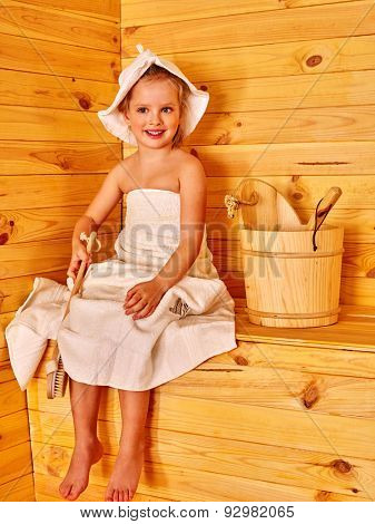 Happy with child in hat relaxing at sauna.