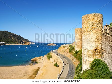 a view of the Platja Gran beach and the walls of the Vila Vella, the old town, of Tossa de Mar, Spain