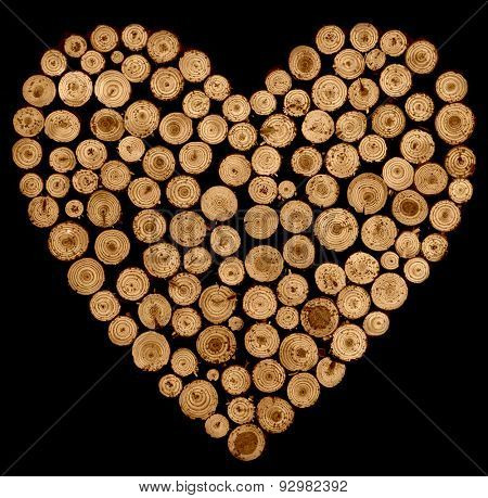 wooden heart made of wooden sticks on black background