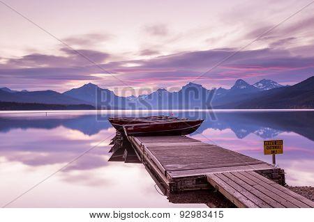 Boats Sit On The Dock At Lake Mcdonald