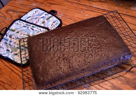 Chocolate Cake Cooling On Wooden Table