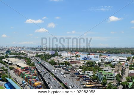 Daytime Transportation And River With Cargo Ship In Bangkok City Thailand