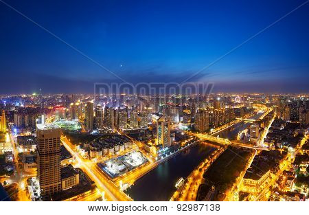 High angle view of panoramic modern skyline in downtown at night