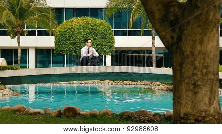 Businessman Meditating Doing Yoga Outside Office Building