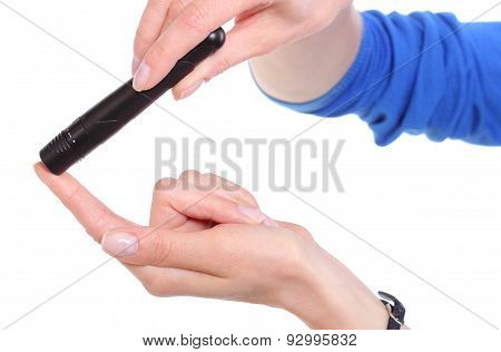 Hand Of Woman Using Lancet On Finger. White Background