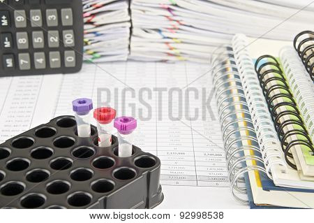 Vacuum Tubes For Collecting Blood Samples And Notebook