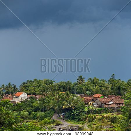 Rural landscape with dramatic clouds on Java, Indonesia